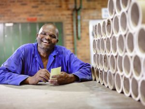 Employees-Mill-Man-with-paper-reel-cores[1]